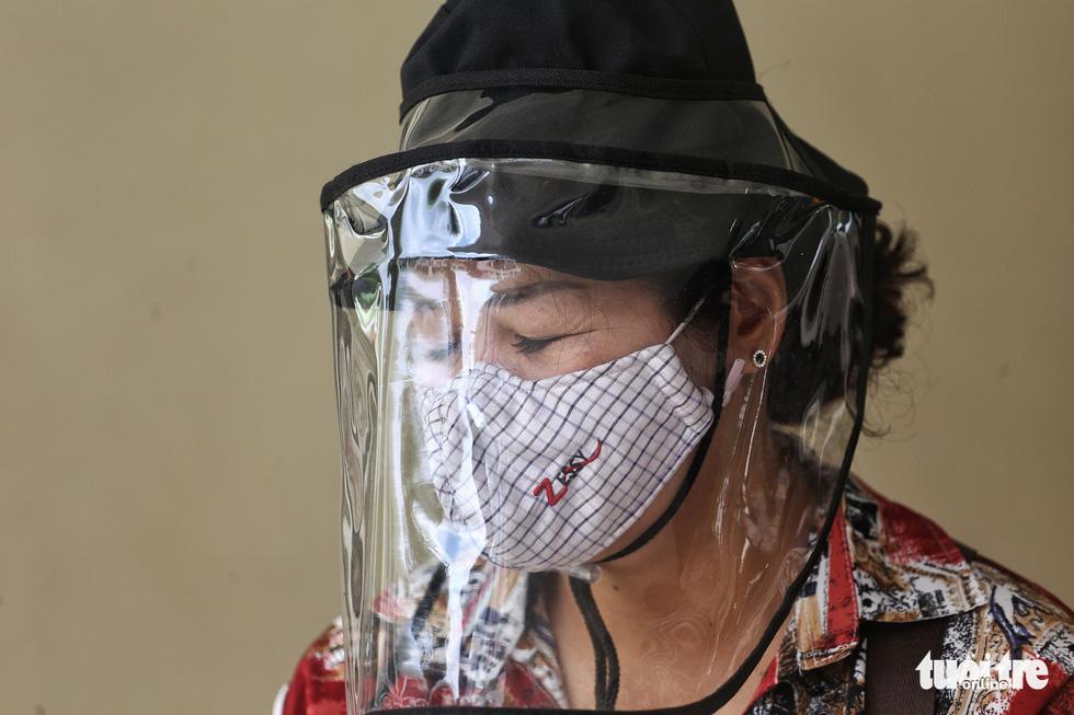 Hà Nội xét nghiệm nhanh COVID-19 cho người trở về từ Đà Nẵng, Quảng Nam - Ảnh 11.