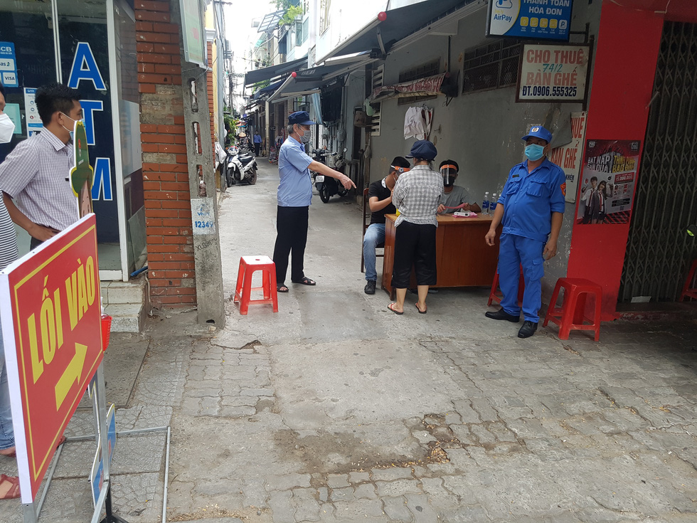 Đi chợ tem phiếu sáng nay ở Đà Nẵng - Ảnh 5.