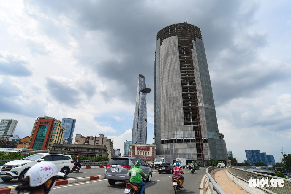 Cận cảnh cao ốc, chung cư, khách sạn... ngàn tỉ đang được rao bán - Ảnh 1.