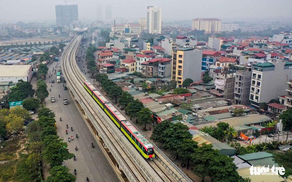 Thủ đô Hà Nội rực rỡ mừng Đại hội Đảng - Ảnh 5.