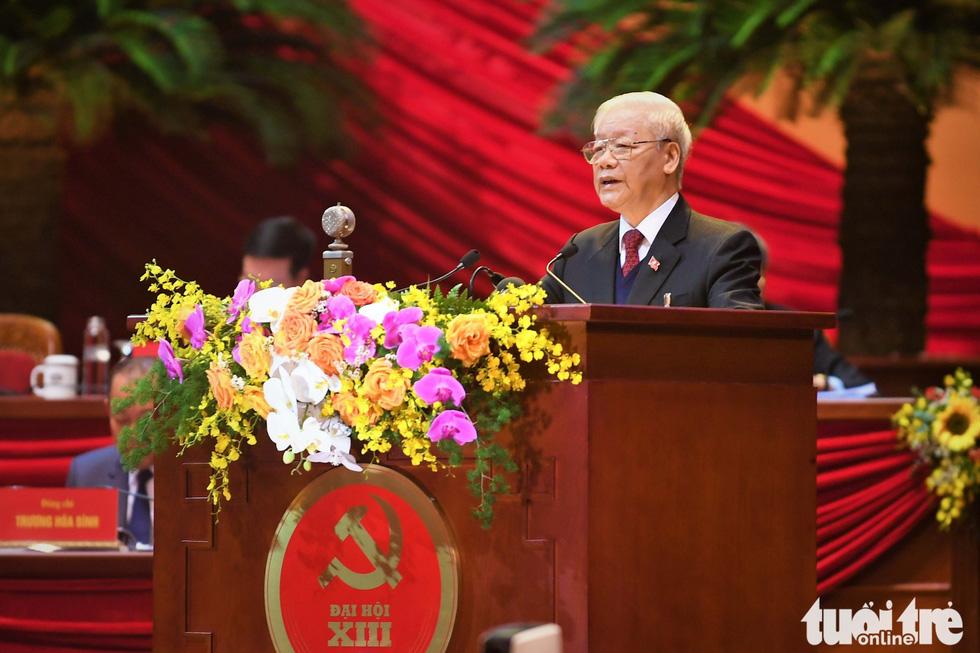 Chùm ảnh lãnh đạo Đảng, Nhà nước và các đại biểu tại phiên khai mạc Đại hội Đảng XIII - Ảnh 3.