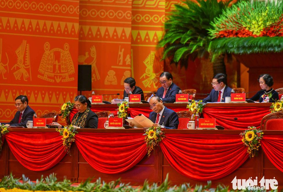 Chùm ảnh lãnh đạo Đảng, Nhà nước và các đại biểu tại phiên khai mạc Đại hội Đảng XIII - Ảnh 5.