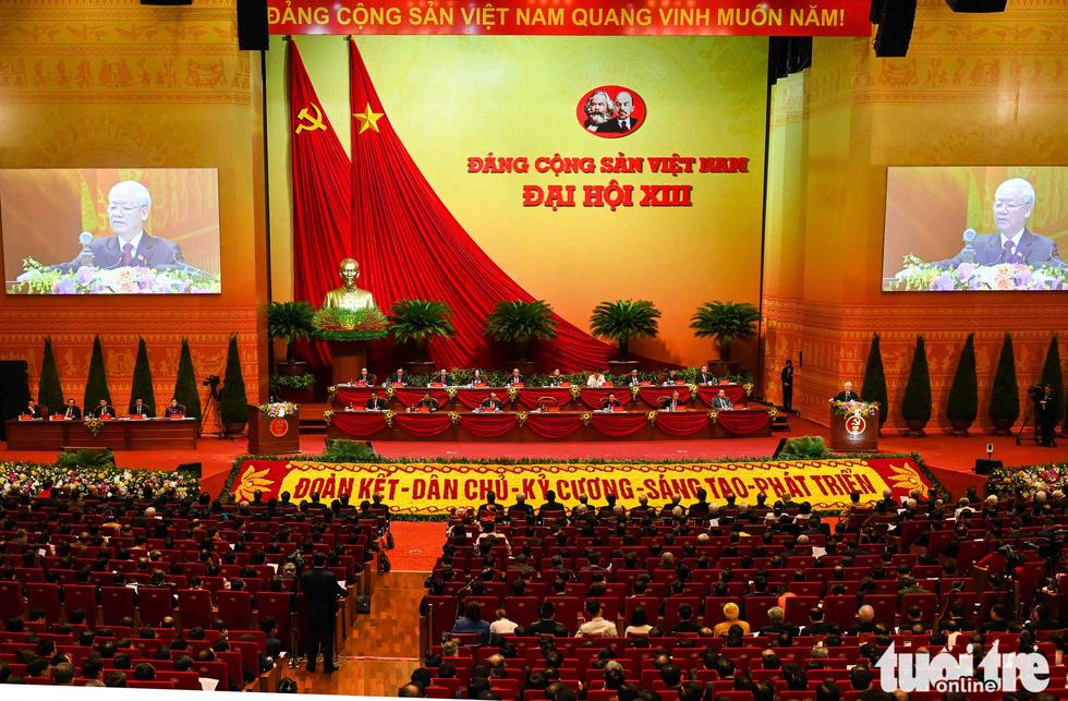 Chùm ảnh lãnh đạo Đảng, Nhà nước và các đại biểu tại phiên khai mạc Đại hội Đảng XIII - Ảnh 2.