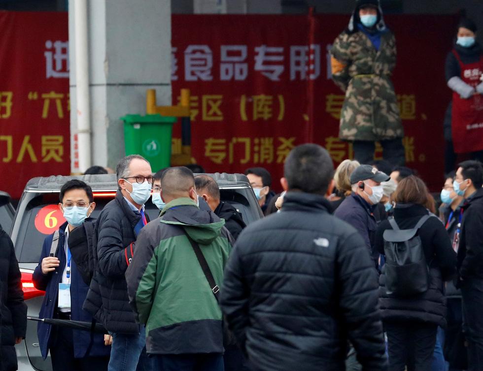 Nhóm chuyên gia WHO đến chợ hải sản ở Vũ Hán, bắt đầu điều tra nguồn gốc COVID-19 - Ảnh 3.