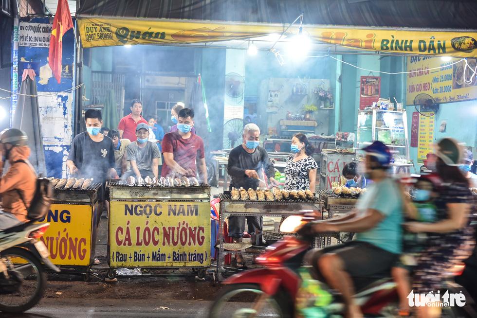 Nửa đêm người dân đi mua cá lóc để vía Thần Tài - Ảnh 5.