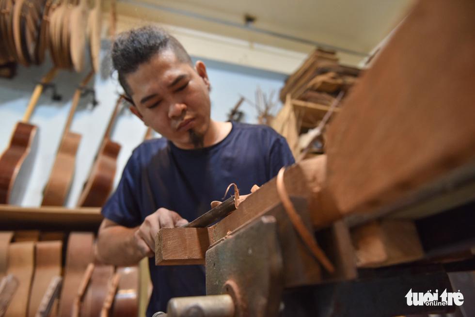 Đôi vợ chồng Sài Gòn 15 năm làm đàn handmade - Ảnh 6.