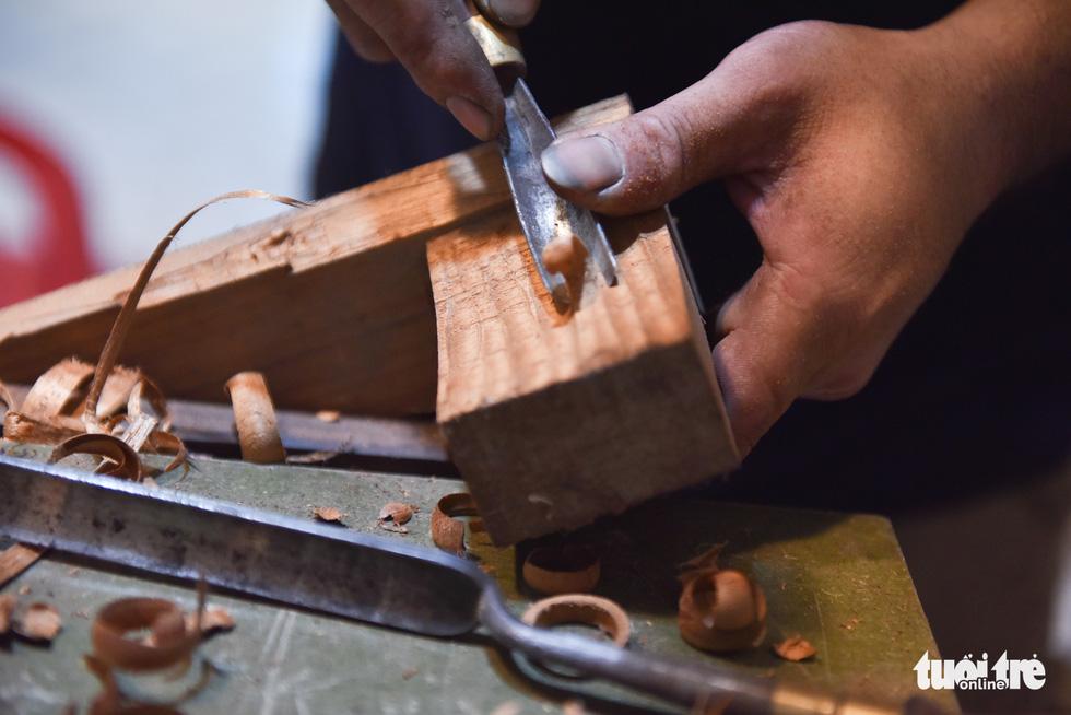 Đôi vợ chồng Sài Gòn 15 năm làm đàn handmade - Ảnh 7.