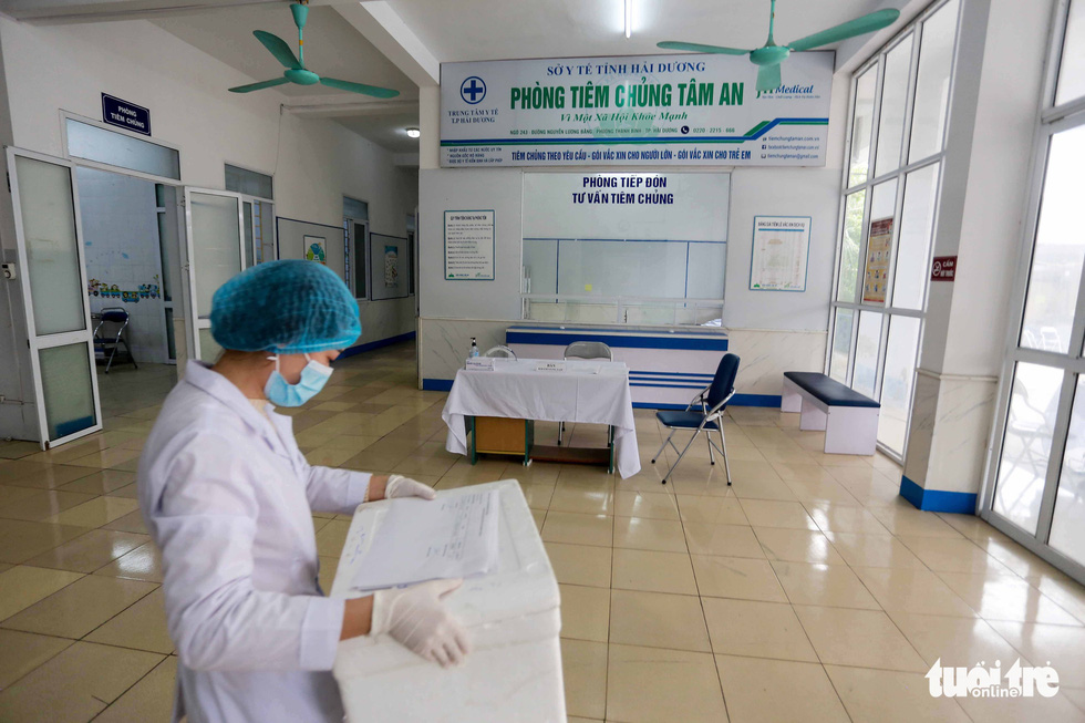 Điểm tiêm vắc xin ngừa COVID-19 ở Hải Dương trước giờ G - Ảnh 1.
