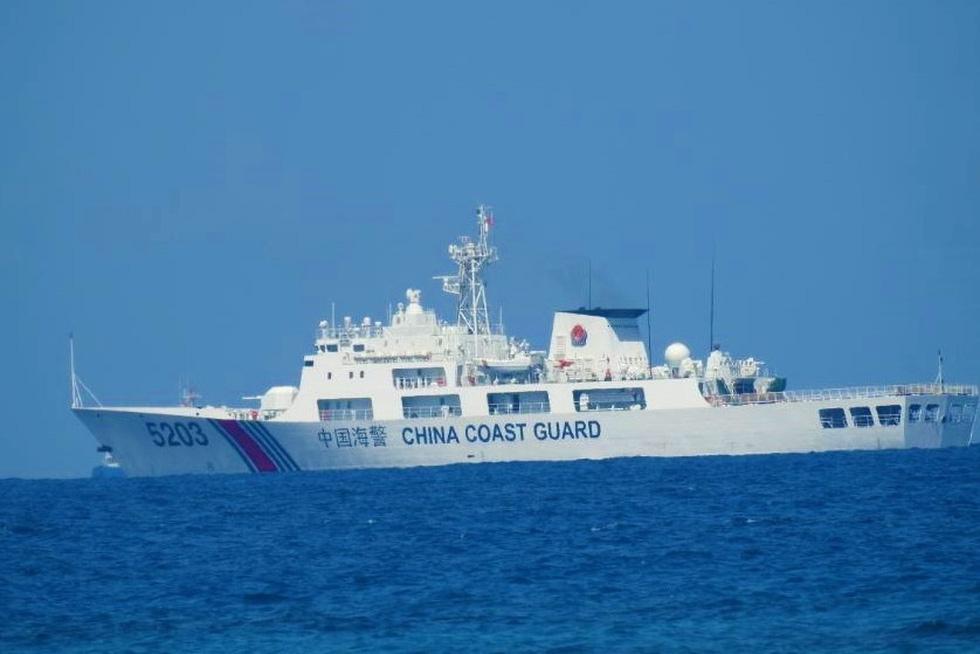 Philippines công bố hình ảnh áp sát tàu Trung Quốc tại đá Ba Đầu - Ảnh 8.