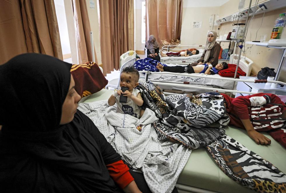 Người dân khổ nạn vì xung đột Israel - Palestine - Ảnh 10.