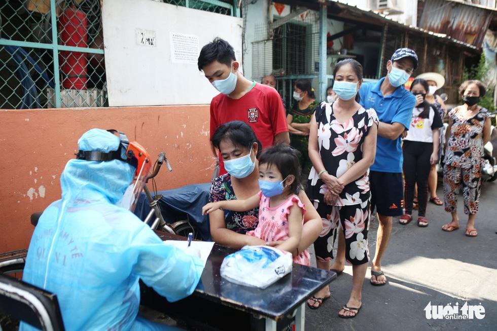 Khẩn cấp xét nghiệm toàn bộ người dân hẻm 245 khu Mả Lạng - Ảnh 4.