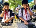 Trường lắp điện thoại bàn để học trò ít dùng di động