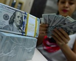 Giá USD tự do giảm về gần bằng giá USD ngân hàng