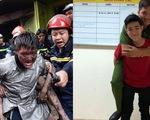 Chàng trai được cứu trong đám cháy cõng