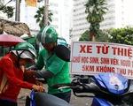 """""""Thằng hâm"""" chạy Grab miễn phí khắp Sài Gòn"""