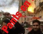 Thực hư ảnh người đàn ông Hồi giáo cười trước nhà thờ Đức Bà Paris cháy