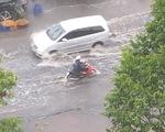 TP.HCM mưa diện rộng, nhiều tuyến đường ngập nước