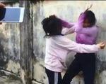 Học sinh cấp 2 cổ vũ, quay clip bạn học đánh nhau, trường nói