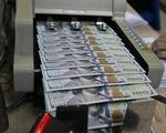 Giá đôla, giá vàng cùng tăng trưa nay