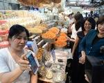 Dịch COVID-19 tạo thói quen 'không tiền mặt' tại châu Á - Thái Bình Dương