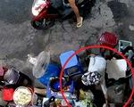 Bà cụ bị người mua nước lấy trộm túi tiền: 'Không ngờ người lớn dạy trẻ con ăn cắp
