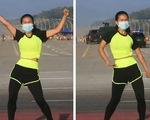 Cô gái thản nhiên tập thể dục giữa chính biến ở Myanmar?