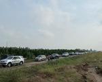 Quốc lộ 1 kẹt xe, xe cộ hỗn loạn chạy vào cao tốc Trung Lương - Mỹ Thuận