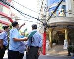 Cưỡng chế cắt 3 lầu vượt phép của khách sạn bề thế ở quận 10