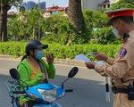Hà Nội: Cảnh sát giao thông và công an xã, phường sẽ duyệt, cấp giấy đi đường cho người dân