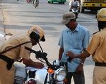 Mua bảo hiểm xe máy 5.000-10.000 đồng khỏi bị CSGT phạt?