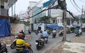 Các hộ dân tháo dỡ nhà, mở rộng nút cổ chai đường Bùi Đình Túy
