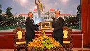 Chia sẻ với Lào kinh nghiệm phát triển nhanh và bền vững