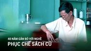 Người đàn ông 40 năm gắn bó với nghề phục chế sách cũ ở Sài Gòn