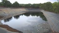 Người dân lo lắng hồ chứa nước rỉ thải từ bãi rác sẽ tràn