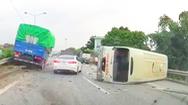 Video: Xe tải lao lên dải phân cách sau khi húc lật xe khách trên cao tốc