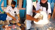 Video: Phải dựng lều đếm 9 bao tiền của cụ ông mang gửi ngân hàng