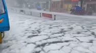 Video: Mưa đá ở Trung Quốc, đường phố biến thành sông băng