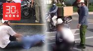Bản tin 30s Nóng: Đau thấu trời cha ôm thi thể con sau tai nạn; Để tài xế một mình vật với cướp, cảnh cáo đại úy công an