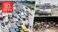 Bản tin 30s Nóng: Ùn ứ ở nhiều cửa ngõ; Xe cứu thương chở khách; CSGT dẫn đường cho người dân về quê