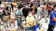 Video: Người dân Vũ Hán đổ xô vào siêu thị, nhiều kệ hàng trống trơn