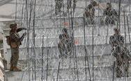 Mỹ gia cố hàng rào thép gai khi đoàn di dân tiến gần biên giới