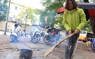 Không khí lạnh tăng cường, dân Hà Nội bắt đầu đốt củi sưởi ấm