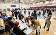 Bầu cử giữa kỳ ở Mỹ: Mở màn với mưa gió và trục trặc kỹ thuật