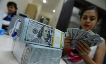 Giá USD tăng vọt sau khi FED tăng lãi suất