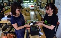 Thời 'thanh toán một chạm', người mua kẻ bán đều hưởng lợi