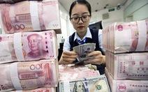 Mỗi 'công dân toàn cầu' ôm nợ 32.500 USD