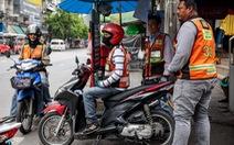 Xe ôm truyền thống và xe ôm Grab tử chiến tại Bangkok