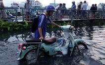 Triều cường kỷ lục, nước sông nước cống bủa vây nhiều tuyến đường TP.HCM