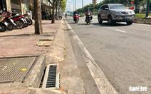 Bắt kẻ trộm 50 nắp chắn rác trên đường Phạm Văn Đồng