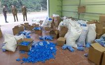 Tạm giữ hơn 8 tấn găng tay y tế đã sử dụng, không rõ nguồn gốc
